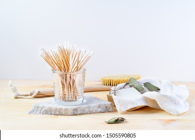 Zero waste supplies for personal hygiene: bamboo q-tips, eco soap, wooden cactus brush. Sustainable lifestyle, plastic free concept. Horizontal image with copy space