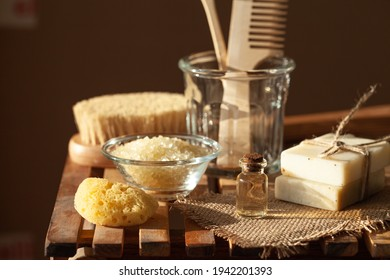 Zero waste and sustainable lifestyle concept. Eco-friendly bathroom accessories. Handmade soap, organic essential oil, sea salt, wooden background. Home body and face care. Contrast light, close-up - Shutterstock ID 1942201393