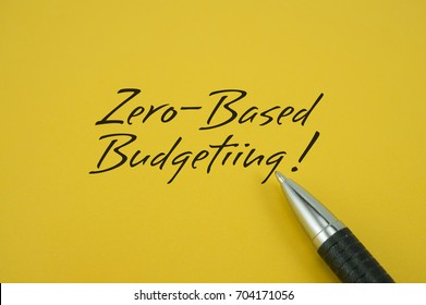 Zero-Based Budgeting! note with pen on yellow background