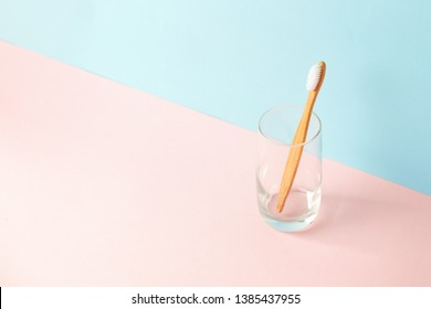 Zero-waste, biodegradable bamboo toothbrush and glass modern 3d background, minimal eco-friendly concept, copy space