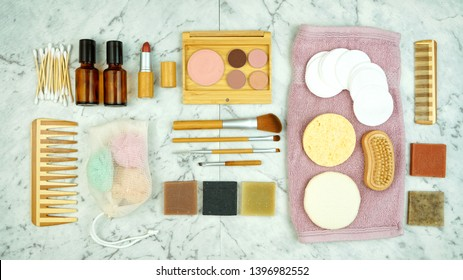 Zero-waste, plastic-free beauty and makeup flatlay overhead with coconut fiber, bamboo and reusable products.