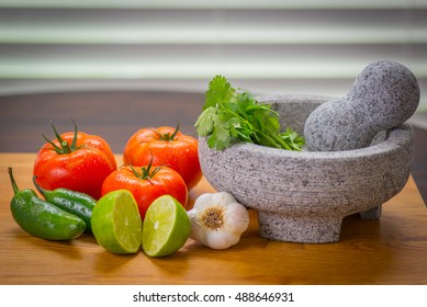 Zesty salsa with tomato and peppers, pico de gallo molcajete (mortar) and tejolete (pestle)