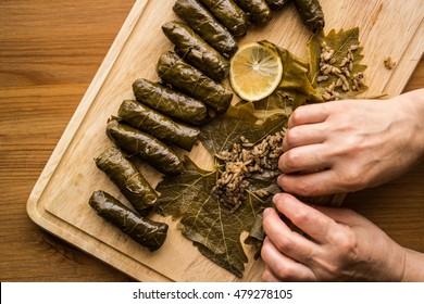 Zeytinyagli Yaprak Sarma / Stuffed Graped leaves wrapping with hands.