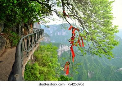 Zhangjiajie, China - May 10, 2017: Detail of red ribbons in Wish Forest Zhangjiajie National Park, China.