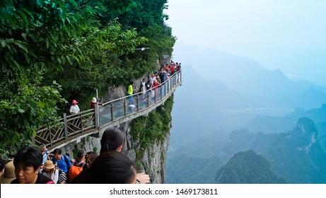 zhangjiajie/China - Circa July, 2019:Tourists walk on the cliff walkway. At Tianmen Shan mountain, The tallest mountain in zhangjiajie.Hunan province,China.