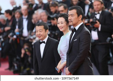 Zhangke Jia, Zhao Tao, Fan Liao  attend the screening of 'Ash Is Purest White (Jiang Hu Er Nv)' during the 71st  Cannes Film Festival at Palais on May 11, 2018 in Cannes, France.
