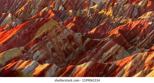 Zhangye Danxia National Geopark - Gansu Province, China. Chinese Danxia multicolor danxia landform, rainbow hills, unusual colored rocks, sandstone erosion, layers of Red, Yellow and Orange stripes.