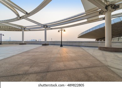 Zhanjiang, China, August 27, 2016:Outdoor ceramic tile floor and steel at sunrise and sunset