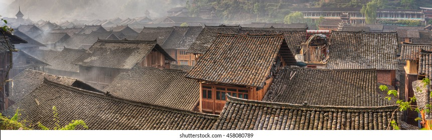Zhaoxing Village, Guizhou Province, China -  April 9, 2010: Liping County, Qiandongnan Miao and Dong Autonomous Prefecture, Tile roofs of wooden houses in a large ancient village, panoramic picture.