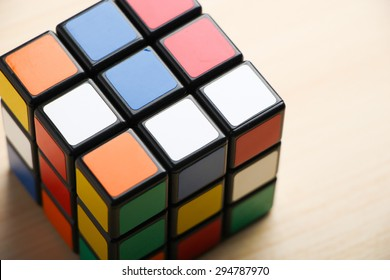 ZHEJIANG, CHINA- MAY 31, 2015: Rubik's cube on the wooden background, Rubik's cube invented by a Hungarian architect Erno Rubik in 1974.