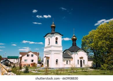 Zheleznyaki, Vetka District, Gomel Region, Belarus. Belfry And Church Of St Nicholas The Wonderworker In Sunny Spring Or Summer Day. Orthodox Church Of St. Nikolaya Chudotvortsa