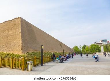ZHENGZHOU, CHINA - APRIL 14, 2014 - The Shang Dynasty (1600-1000BCE) city wall remnants in downtown Zhengzhou, one of China's ancient capitals