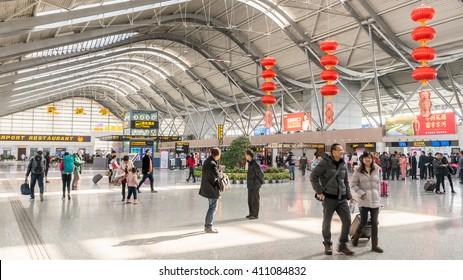ZHENGZHOU, CHINA - FEBRUARY 5, 2016: Zhengzhou Xinzheng International Airport terminal 2 departure hall, airport full of passengers, red lanterns during Chinese New Year festival
