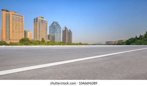 Zhengzhou cityscape with asphalt road in foreground