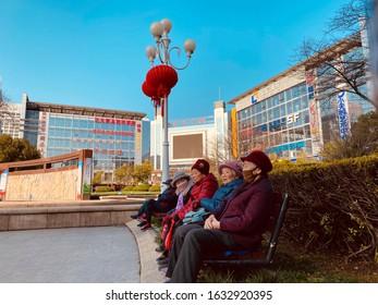 Zhenjiang, Jiangsu Province, China - February 01, 2020: Senior adults wearing a mask for protect from corona virus in public.