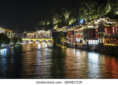 ZHENYUAN, GUIZHOU/CHINA-JUL. 2020: Night view of Zhenyuan Ancient City scenery in Zhenyuan, Guizhou, China. It is located in the east of Guizhou Province, China.
