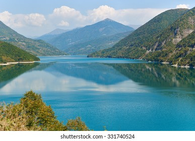 Zhinvali reservoir lake landscape with mountains . The main Caucasus ridge.