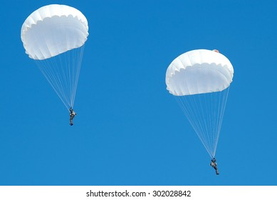 Zhitomir, Ukraine - 28 February 2006. Couple paratroopers parachute jumps in the winter.
