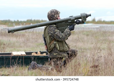 Zhitomir, Ukraine - October 2, 2013. A soldier with MANPADS Igla-1 in firing position