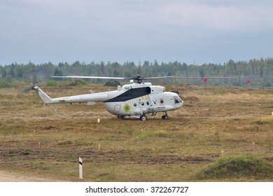 Zhitomir, Ukraine - Septermber 29, 2010: Army transport helicopter Mil Mi-8 landed on the battlefield during the training