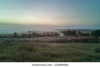 Zhizdra River valley in thick fog panorama at dawn
