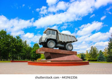 Zhodino, Belarus, in the summer. Monument of the core enterprises of the city Zhldina. BelAZ plant.