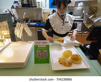 Zhongshan,China-August 26, 2017:buying bread with payment via QR code of Wechat or Alipay.QR code for payment and money transfering becomes very common and popular in China.