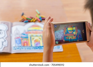 Zhongshan,China-August 29, 2017:kid playing Augmented Reality popup paintings of the color filled Taj Mahal via mobile. AR and VR games become more and more popular.