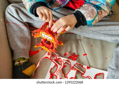 Zhongshan,China-January 26,2019:kid making a traditional Chinese lantern for the new year on his own