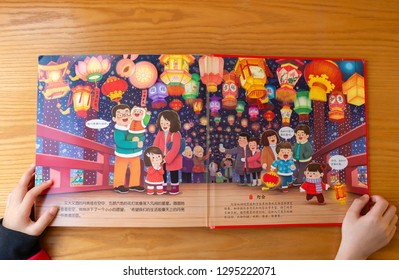 Zhongshan,China-January 26,2019:kid reading 3D books introducing cultures about Chinese new year at home