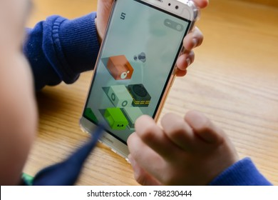Zhongshan,China-January 7,2018:kid playing mobile game inside Wechat owned by Tencent.Tencent creates lots of popular mobile games & this Jumping game spreads out very fast in the new year of 2018.