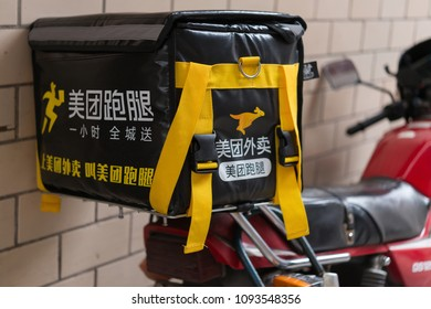Zhongshan,China-May 12,2018:motobike with Meituan food delivery case parking on the street.Food delivery service becomes very popular in China.