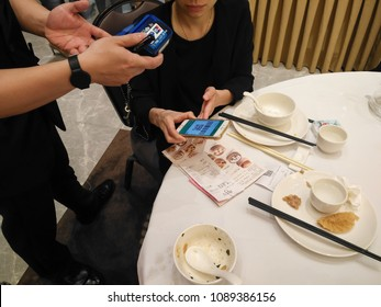 Zhongshan,China-May 13, 2018:doing payment at a restaurant via Wechat money on mobile.Wechat or Alipay for payment and money transfering via mobile becomes very common and popular in China,fast safe.