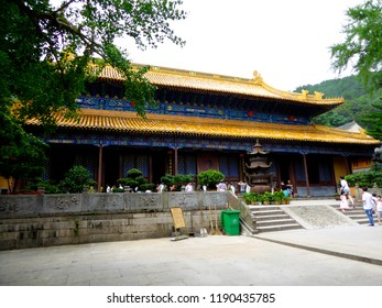 Zhoushan,Zhejiang,China.July 19th,2014.Magnificent palace architecture with a copper incense burner standing in the front in Fayu temple of putuo mountain zhoushan city zhejiang province China.