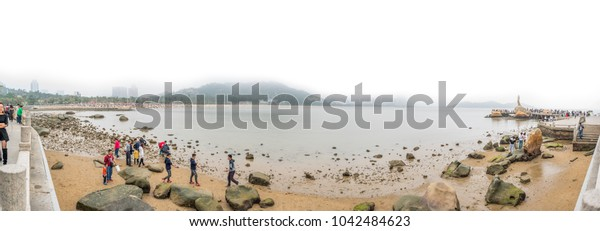 Zhuhai, China - 3 March 2018 : A lot of people come to Xianglu bay to relax on the beach.