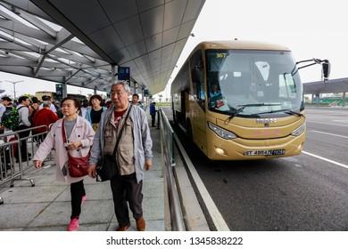 Zhuhai, China - February 6, 2019:Tourists wait at the Zhuhai port of the Hong Kong-Zhuhai-Macao Bridge for a shuttle bus to Hong Kong.