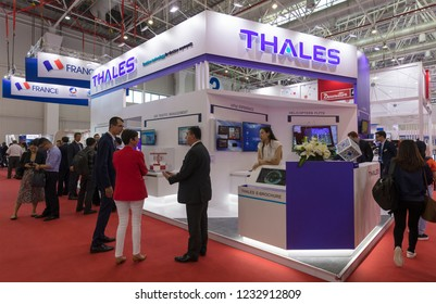 ZHUHAI, CHINA- NOVEMBER 6, 2018: Unidentified people is seen at the THALES booth during the 12th China International Aviation and Aerospace Exhibition