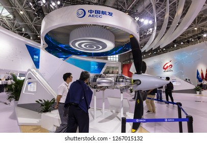 ZHUHAI, CHINA- NOVEMBER 6, 2018: Visitors take a look of an AEP80 engine model on display during the 12th China International Aviation and Aerospace Exhibition, also known as Airshow China 2018