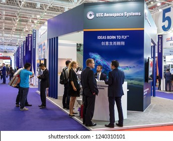 ZHUHAI, CHINA- NOVEMBER 7, 2018: Unidentified people are seen at the UTC Aerospace Systems booth during the 12th China International Aviation and Aerospace Exhibition, also known as Airshow China 2018