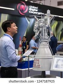 ZHUHAI, CHINA- NOVEMBER 7, 2018: An unidentified man takes a look of a RD-191 liquid rocket engine mockup at the 12th China International Aviation and Aerospace Exhibition