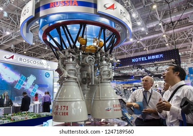 ZHUHAI, CHINA- NOVEMBER 7, 2018: Unidentified people take a look of a RD-171 liquid rocket engine mockup at the 12th China International Aviation and Aerospace Exhibition