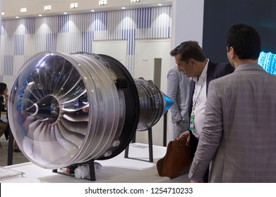 ZHUHAI, CHINA- NOVEMBER 7, 2018: A visitor takes a look of a Rolls-Royce aircraft engine model on display during the 12th China International Aviation and Aerospace Exhibition