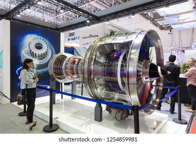 ZHUHAI, CHINA- NOVEMBER 7, 2018: A visitor takes a look of an aircraft engine model on display during the 12th China International Aviation and Aerospace Exhibition, also known as Airshow China 2018