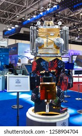 ZHUHAI, CHINA- NOVEMBER 7, 2018: A mockup of Mikhailo Lomonosov astronomical satellite is on display at the Roscosmos booth during the 12th China International Aviation and Aerospace Exhibition.
