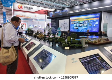 ZHUHAI, CHINA- NOVEMBER 7, 2018: Visitors are seen at the Almaz-Antey Corp. booth during the 12th China International Aviation and Aerospace Exhibition, also known as Airshow China 2018