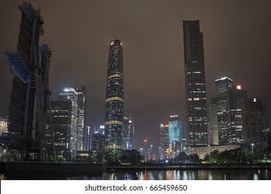 ZHUJIANG NEW TOWN, TIANHE DISTRICT,GUANGZHOU SHI, GUANGDONG, CHINA - APRIL 2017: Guangzhou's new central axis at night over water, with IFC and CTF skyscrapers, Guangzhou China.