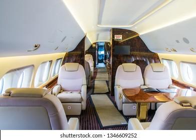 Zhukovskiy, Russia - August 28, 2015: Luxury interior of genuine leather in the modern business jet, Sukhoi Superjet 100 VIP configuration RA-89053 RusJet.