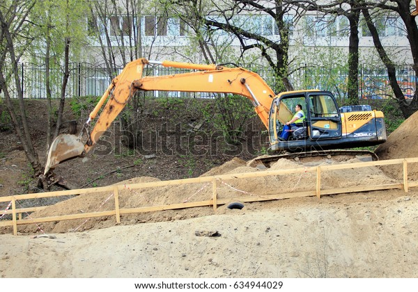 Zhukovskiy, Russia - May 02, 2017: Editorial use only. The excavator builds the road. Road construction machinery.