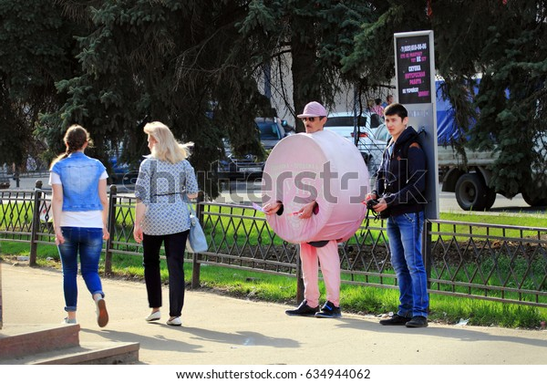 Zhukovskiy, Russia - May 02, 2017: Editorial use only. Advertising agents on the street with passers-by.
