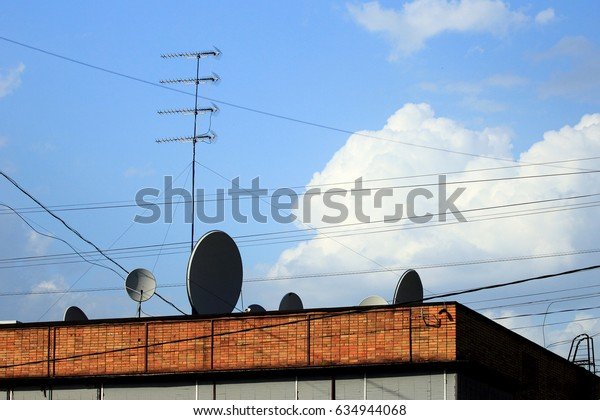 Zhukovskiy, Russia - May 02, 2017: Editorial use only. Satellite antennas on the roof of the house.